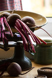 Beetroots on kitchen scales near window. Close up, copy space Royalty Free Stock Photo