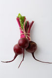 Beetroots on white wood background Royalty Free Stock Photography