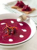 Beetrot soup. With orange and sour cream Royalty Free Stock Photo