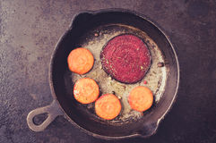 Beets carrots frying in a pan Royalty Free Stock Images