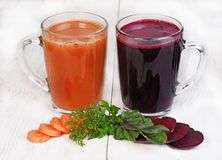 Beets  and carrots juice Royalty Free Stock Photos