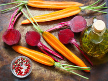 Beets and carrots ready for roasting with olive oil and spices Stock Image