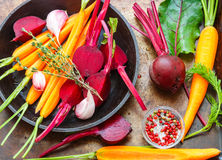 Beets and carrots ready for roasting with olive oil and spices Stock Photo
