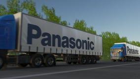 Befördern Sie halb LKWs mit Logo Panasonic Corporation, das entlang Waldweg fährt Redaktionelle Wiedergabe 3D Stockfoto