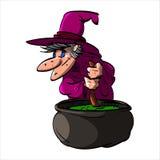 Befana oder eine Hexe mit einem großen Kessel Lizenzfreie Stockfotos