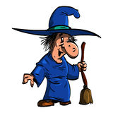 Befana ou une sorcière avec le manche à balai Photos stock