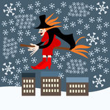Befana witch over the city during a blizzard stock photography
