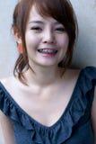 Befestigt asiatisches Mädchenportrait Stockbild