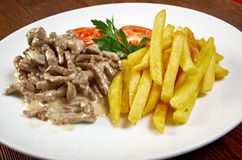 Beff-stroganoff. With fried potatoes Royalty Free Stock Photo