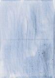 befläckt blått papper Royaltyfria Bilder