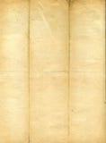 befläckt gammalt papper för grunge Arkivfoto