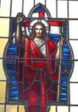 befläckte glass jesus Arkivfoto