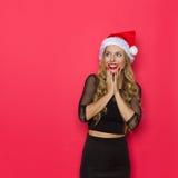 Begeisterte elegante Frau in Santa Hat Stockbilder