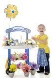 Begeisterter kleiner Blumenhändler Stockfotos