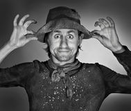 Beggar. A happy beggar holding his hat, studio photo royalty free stock image
