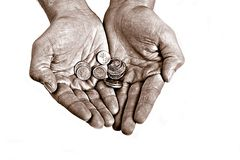 Beggar. A Gypsy's hands holding a silver coin Stock Photo