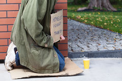 Beggar asking for money and for food Royalty Free Stock Photography
