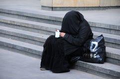 Beggar in Black Dress Stock Photos
