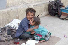 Beggar boy and girl in Leh, India Stock Photos