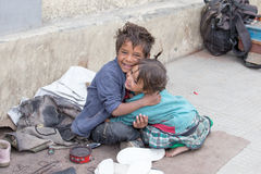 Beggar boy and girl in Leh, India Stock Images