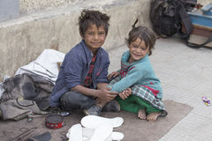 Beggar boy and girl in Leh, India Royalty Free Stock Images
