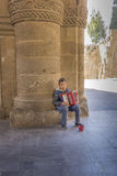 Beggar Boy Playing Accordian Royalty Free Stock Image
