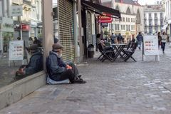 Beggar in Bruxelles. Beggar sitting on the street in Brussel, May 2015 Royalty Free Stock Photos