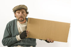 Beggar with cardboard and beret Royalty Free Stock Photography