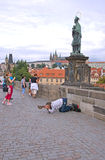 Beggar on the Charles Bridge in Prague Royalty Free Stock Photo