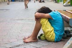 Beggar child boy Stock Photography