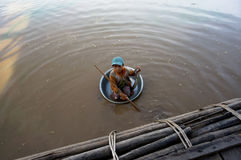 Beggar child floats in a basin of dirty Tonle SAP Royalty Free Stock Photography