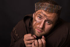 Beggar on a dark background Royalty Free Stock Images