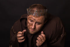 Beggar on a dark background Royalty Free Stock Photo