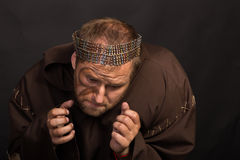 Beggar on a dark background Royalty Free Stock Image