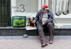 Beggar with dog Stock Photography