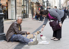 Beggar with dog Royalty Free Stock Images