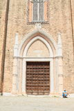 Beggar in front of church in Venice Stock Photography