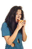Beggar girl eating bread Stock Photo