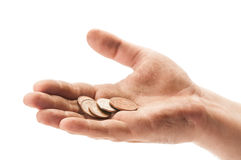 Beggar hand with england coins Stock Images