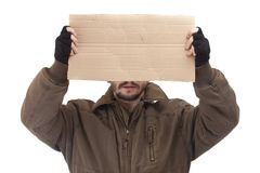 Beggar holding carton Royalty Free Stock Image