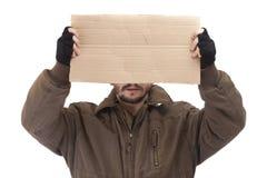 Beggar holding carton Royalty Free Stock Image
