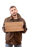 Beggar holding carton Royalty Free Stock Photos