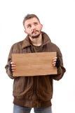 Beggar holding carton Royalty Free Stock Photos