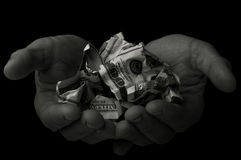 Beggar holds dollars Stock Image