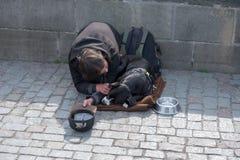 Beggar, homeless with Dog near Charles Bridge, Prague, Czech republic stock photo
