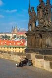 Beggar, homeless kneeling begging in Prague Stock Photos