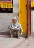 Beggar In Bouddhanath Royalty Free Stock Image