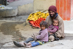 Beggar man with children begging on the street in Leh, Ladakh. India Stock Images