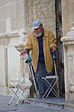 Beggar man at the door of a church 16 Royalty Free Stock Images
