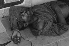 Beggar man sleeping in the streets of Santo Domingo, Dominican Republic royalty free stock images